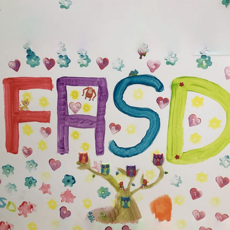 FASD written in paint with shape prints