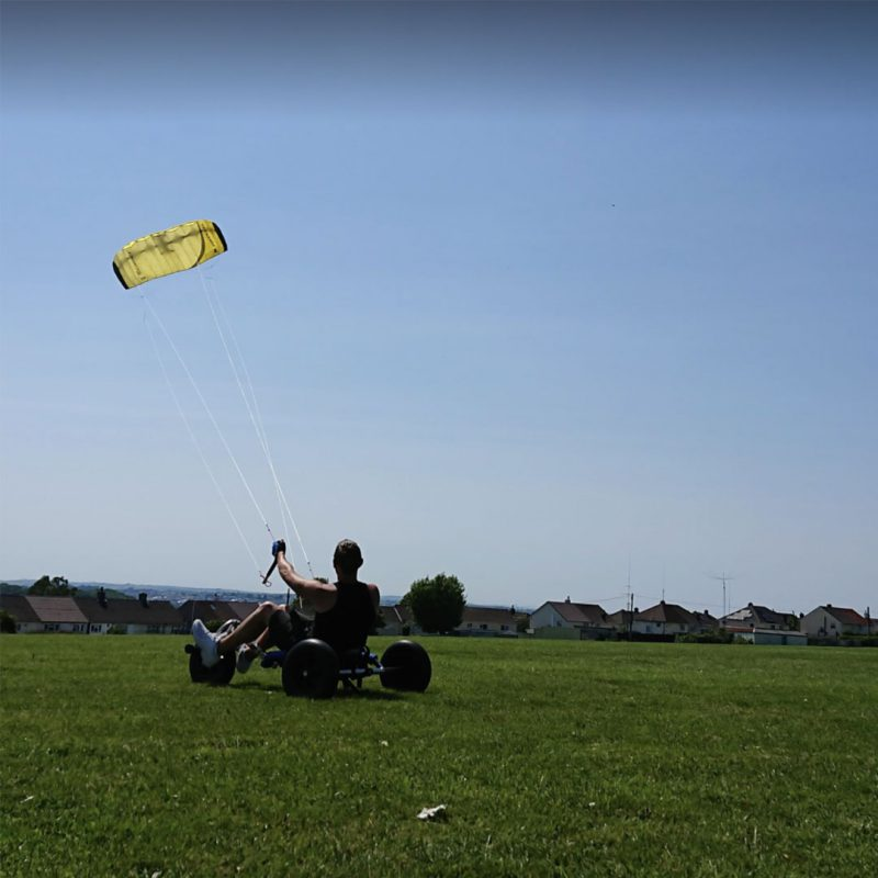 Man with FASD kitesurfing on a sunny day