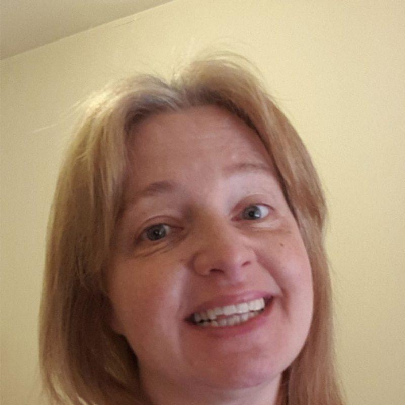 Nyrene smiling at camera