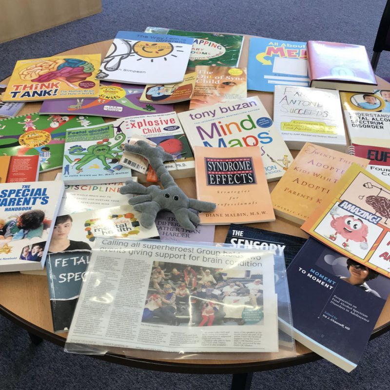 Round table full of books about FASD
