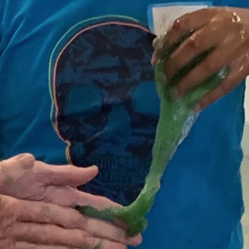 Parent and young person hands in green slime