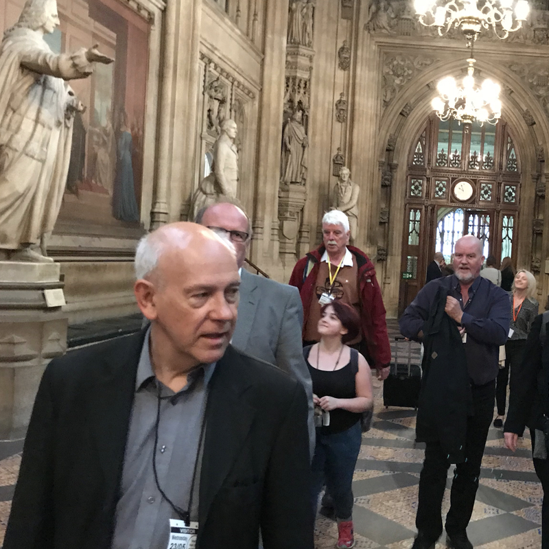 Man walking ahead of others in parliament