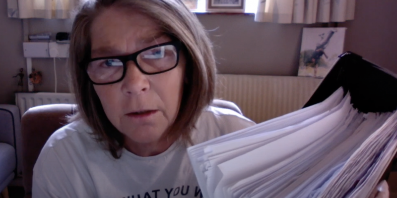 Mum holding a stack of medical records